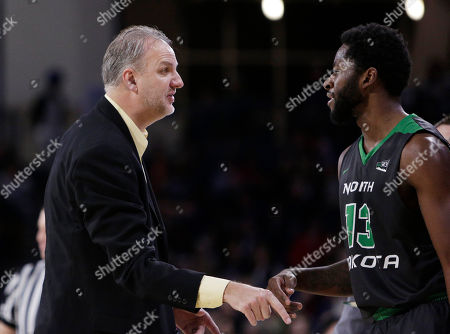 Brian Jones, Dale Jones. North Dakota head coach Brian Jones, left, speaks with forward Dale Jones during the second half of an NCAA college basketball game against Gonzaga in Spokane, Wash