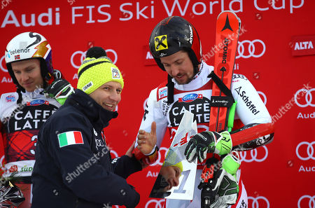 Italian Sport Minister Luca Lotti congratulates with Austria's Marcel Hirscher, right, winner of an alpine ski, men's World Cup giant slalom in Alta Badia, Italy
