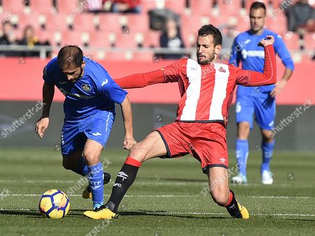 Christian Stuani of Girona CF and Sergio Mora of Getafe CF.