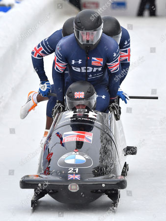 Bradley Hall Nicholas Gleeson, Andrew Matthews, Gregory Cackett of Great Britain start their first run of the men's four-man bobsled World Cup race in Innsbruck