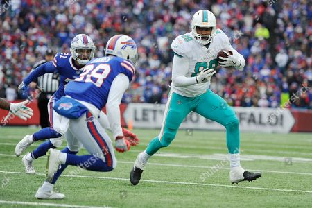 Stock Photo of Miami Dolphins' Julius Thomas (89) plays during the second half of an NFL football game against the Buffalo Bills, in Orchard Park, N.Y
