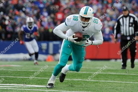 Miami Dolphins' Julius Thomas (89) plays during the second half of an NFL football game against the Buffalo Bills, in Orchard Park, N.Y