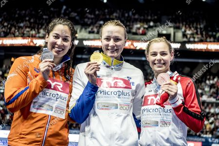 (L-R) Ranomi Kromowidjojo from Netherlands win silver, Sarah Sjoestroem from Sweden win gold and Pernille Blume from Denmark wins bronze in the 50 meter freestyle at the LEN European Short Course Swimming Championships in Royal Arena in Copenhagen, Denmark, 17 December 2017.