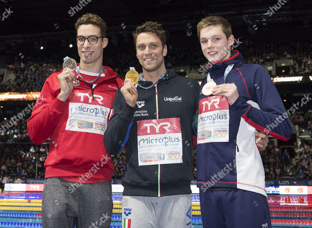 Stock Image of Gold medalist Luca Dotto of Italy (C), silver medalist Pieter Timmers of Belgium (L) and bronze medalist Duncan W. Scott of Britain (R) with their medals after the finals of the 100m Freestyle at the LEN European Short Course Swimming Championships in Royal Arena in Copenhagen, Denmark, 17 December 2017.
