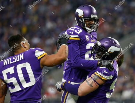 Terence Newman, Eric Wilson, Brian Robison. Minnesota Vikings cornerback Terence Newman (23) celebrates with teammates Brian Robison, right, and Eric Wilson (50) after intercepting a pass during the second half of an NFL football game against the Cincinnati Bengals, in Minneapolis