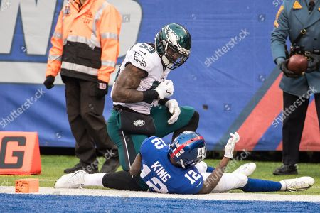 , 2017, Philadelphia Eagles linebacker Nigel Bradham (53) looks over New York Giants wide receiver Tavarres King (12), who just scored a touchdown during the NFL game between the Philadelphia Eagles and the New York Giants at MetLife Stadium in East Rutherford, New Jersey. The Philadelphia Eagles won 34-29