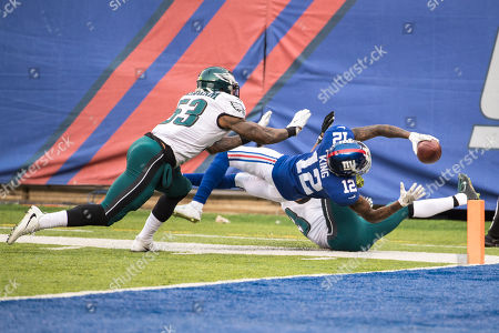 , 2017, New York Giants wide receiver Tavarres King (12) dives for the end zone as he splits between Philadelphia Eagles safety Rodney McLeod (23) and linebacker Nigel Bradham (53) during the NFL game between the Philadelphia Eagles and the New York Giants at MetLife Stadium in East Rutherford, New Jersey. The Philadelphia Eagles won 34-29