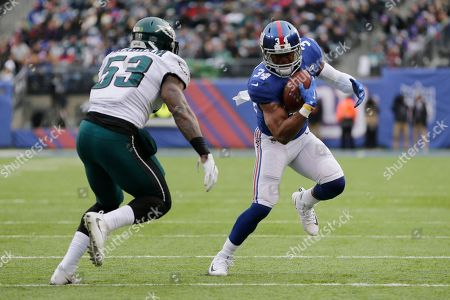 New York Giants running back Shane Vereen (34) runs with the ball as Philadelphia Eagles outside linebacker Nigel Bradham (53) moves in for the tackle during the first half of an NFL football game, in East Rutherford, N.J