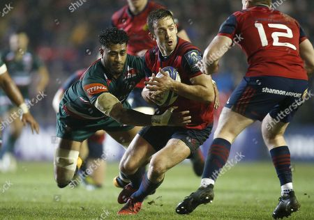 Darren Sweetnam of Munster rugby tackled by Valentino Mapapalangi of Leicester Tigers