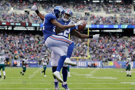 New York Giants wide receiver Tavarres King, left, and running back Wayne Gallman celebrate King's touchdown catch against the Philadelphia Eagles during the first half of an NFL football game, in East Rutherford, N.J