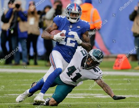 New York Giants wide receiver Tavarres King (12) runs for a touchdown after catching a pass from quarterback Eli Manning, not pictured, as Philadelphia Eagles cornerback Ronald Darby (41) tries to stop him during the second half of an NFL football game, in East Rutherford, N.J