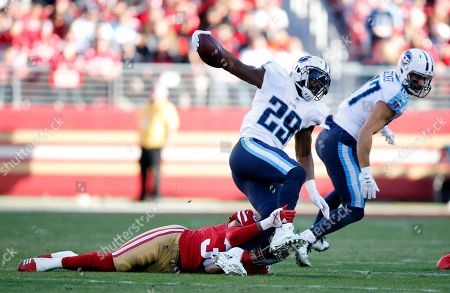 Tennessee Titans running back DeMarco Murray, top, is tackled against the San Francisco 49ers during the second half of an NFL football game, in Santa Clara, Calif