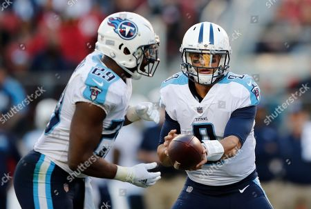 Stock Picture of Tennessee Titans quarterback Marcus Mariota (8) hands off to running back DeMarco Murray (29) during the second half of an NFL football game against the San Francisco 49ers, in Santa Clara, Calif