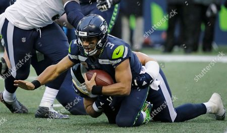 Seattle Seahawks quarterback Russell Wilson (3) is sacked by Los Angeles Rams outside linebacker Connor Barwin in the second half of an NFL football game, in Seattle