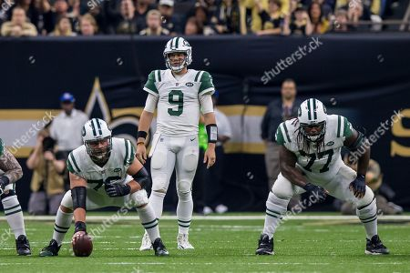 New York Jets quarterback Bryce Petty (9) looks on with center Wesley Johnson (76) and offensive guard James Carpenter (77) against New Orleans Saints during the second half at the Mercedes-Benz Superdome in New Orleans, LA. New Orleans Saints defeated New York Jets 31-19