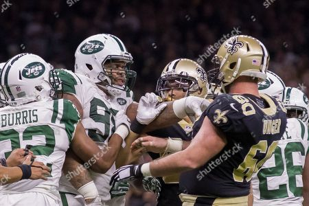 New Orleans Saints center Max Unger (60) and New York Jets defensive end Mike Pennel (98) argue about a play during the second half at the Mercedes-Benz Superdome in New Orleans, LA. New Orleans Saints defeated New York Jets 31-19