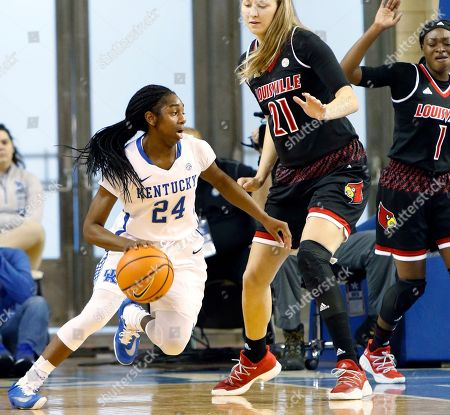 Taylor Murray, Kylee Shook, Dana Evans. Kentucky's Taylor Murray (24) looks for an opening on Louisville's Kylee Shook (21) and Dana Evans (1) during the first half of an NCAA college basketball game, in Lexington, Ky