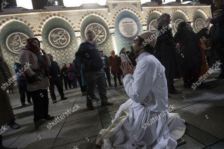 Dervis prays after the 'Seb-i Arus' celebration to dance and chant to Sufi music in front of the Selimiye Mosque in Konya, Turkey,  17 December 2017. 'Seb-i Arus' means reunited with the Beloved One. Mevlana's death is considered in Sufism to be his reunion with God. Poet Mevlana Jalal al-Din al-Rumi is an illustrious personage of Sufism is the mystical form of Islam. Rumi died on 17 December 1273.