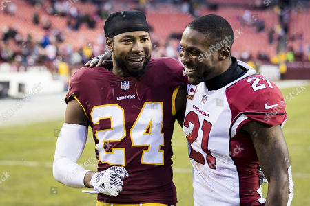 Washington Redskins cornerback Josh Norman (24) and Arizona Cardinals cornerback Patrick Peterson (21) talk after the NFL game between the Arizona Cardinals and the Washington Redskins at FedExField in Landover, Maryland