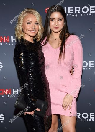 Kelly Ripa, Lola Consuelos. Co-host Kelly Ripa, left, and daughter Lola Consuelos attend the 11th annual CNN Heroes: An All-Star Tribute at the American Museum of Natural History, in New York