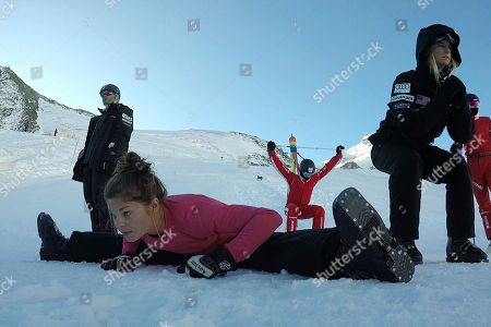 From a 4K video and dated shows Ashley Caldwell, front, and other members of the US and Swiss aerial skiing national teams warming up before training in Saas-Fee, Switzerland. Because snow is no longer guaranteed early in the season at their headquarters in Park City, Utah, she and other members of the US aerials national team went to train high on the Saas-Fee glacier ahead of the 2018 Pyeongchang Olympics