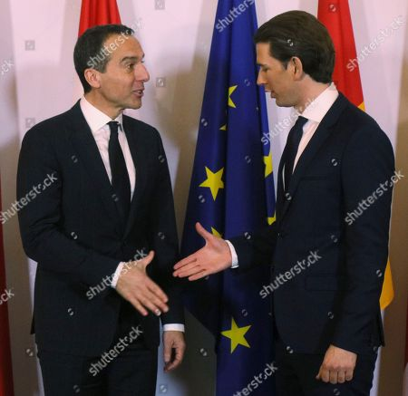 Outgoing Austrian Chancellor Christian Kern, left, hands over the chancellery to his successor Sebastian Kurz, right, after the swearing-in ceremony of the new Austrian government led by a conservative and a nationalist party in Vienna, Austria