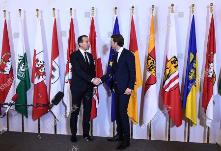 Stock Photo of Austrian Chancellor Sebastian Kurz (R), the leader of the Austrian Peoples Party (OeVP) and outgoing Austria's Chancellor Christian Kern shake hands during the hand over ceremony in Vienna, Austria, 18 December 2017. The OeVP and FPOe parties have formed the new coalition government after holding coalition negotiations talks after the general elections in October 2017.