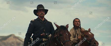 Stock Picture of Christian Bale, Adam Beach