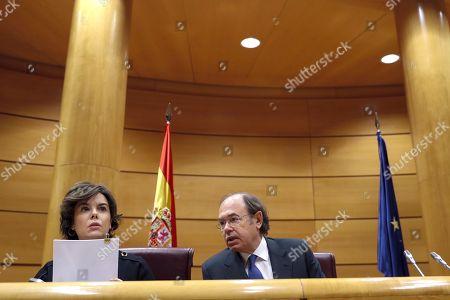 Soraya Saez de Santamaria and Pio Garcia-Escudero