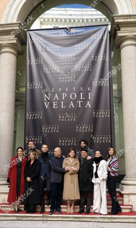 Turkish-born Italian filmmaker Ferzan Ozpetek (C) with Italian actors/cast members Giovanna Mezzogiorno, Alessandro Borghi, Anna Bonaiuto, Peppe Barra, Biagio Forestieri, Lina Sastri, Luisa Ranieri and Maria Pia Calzone pose for photographs during the photo call for the movie 'Napoli velata', in Rome, Italy, 18 December 2017. The movie will be released in Italian theaters on 28 December.