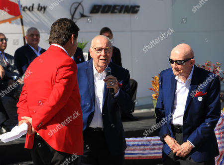 Astronaut Jim Lovell, center, speaks, accompanied by fellow astronaut Tom Stafford, right, during the ribbon cutting ceremony for the Heroes and Legends exhibit at the Kennedy Space Center Visitor Complex in Florida on . At left is the master of ceremonies, John Zarrella, formerly of CNN