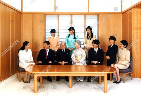 Akihito, Michiko, Naruhito, Masako, Aiko, Akishino, Kiko, Mako, Kako, Hisahito. And released by the Imperial Household Agency of Japan, Japanese Emperor Akihito, seated third left, and Empress Michiko, seated fourth left, smile with their family members during a photo session for the New Year at the Imperial Palace in Tokyo. They are: Crown Prince Naruhito, seated second left, his wife, Crown Princess Masako, seated left, their daughter, Princess Aiko, top left, Prince Akishino, seated second right, his wife, Princess Kiko, seated right, their daughters, Princess Mako, top center, and Princess Kako, top right, and their son, Prince Hisahito