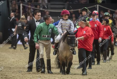 Frankie Dettori congratulating his son Rocco after winning the race
