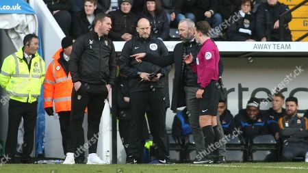 Referee Anthony Backhouse has a word with Kevin Nolan and Shaun Derry