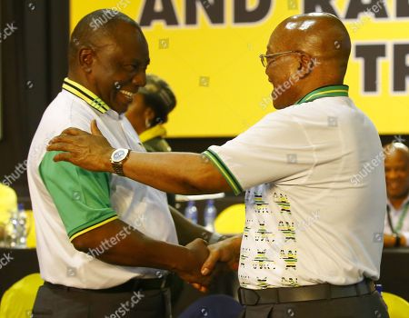 New ANC President Cyril Ramaphosa (L) celebrates with outgoing president, Jacob Zuma (R) on stage after winning the presidential race during the 54th ANC National Conference held at the NASREC Convention Centre, Johannesburg, South Africa, 18 December 2017. President Cyril Ramaphosa Nkosazana Dlamini-Zuma succeeds outgoing ANC President, Jacob Zuma and becomes the 4th ANC President since the end of Apartheid. The ruling ANC has been reeling recently under allegations of corruption and and loss of support from its core voters. The ANC (African National Congress) formally led by Nelson Mandela, led the country to freedom from white rule and the Apartheid system during the first free and fair elections in 1994. The convention ends Wednesday.