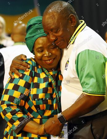 New ANC President Cyril Ramaphosa (R) hugs losing presidential hopeful,  Nkosazana Dlamini-Zuma (L) celebrates on stage after winning the presidential race during the 54th ANC National Conference held at the NASREC Convention Centre, Johannesburg , South Africa, 18 December 2017. President Cyril Ramaphosa Nkosazana Dlamini-Zuma succeeds outgoing ANC President, Jacob Zuma and becomes the 4th ANC President since the end of Apartheid. The ruling ANC has been reeling recently under allegations of corruption and and loss of support from its core voters. The ANC (African National Congress) formally led by Nelson Mandela, led the country to freedom from white rule and the Apartheid system during the first free and fair elections in 1994. The convention ends Wednesday.