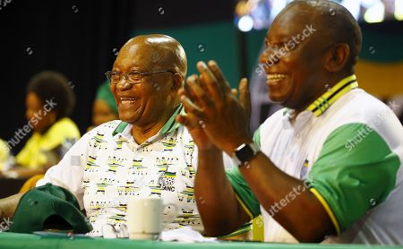 New ANC President Cyril Ramaphosa (R) with outgoing president, Jacob Zuma (L) on stage after winning the presidential race during the 54th ANC National Conference held at the NASREC Convention Centre, Johannesburg , South Africa, 18 December 2017. President Cyril Ramaphosa Nkosazana Dlamini-Zuma succeeds outgoing ANC President, Jacob Zuma and becomes the 4th ANC President since the end of Apartheid. The ruling ANC has been reeling recently under allegations of corruption and and loss of support from its core voters. The ANC (African National Congress) formally led by Nelson Mandela, led the country to freedom from white rule and the Apartheid system during the first free and fair elections in 1994. The convention ends Wednesday.