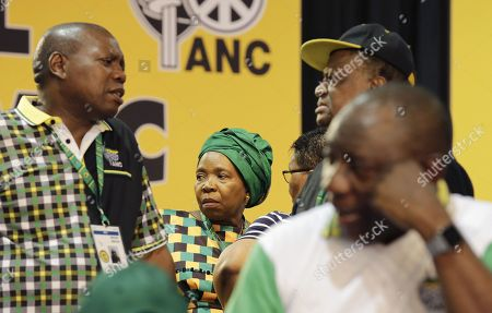 ANC Presidential hopeful Nkosazana Dlamini-Zuma (centre, back) awaits the results of the presidential race during the 54th ANC National Conference held at the NASREC Convention Centre, Johannesburg, South Africa, 18 December 2017. President Cyril Ramaphosa succeeded outgoing ANC President, Jacob Zuma and becomes the 4th ANC President since the end of Apartheid. The ruling ANC has been reeling recently under allegations of corruption and and loss of support from its core voters. The ANC (African National Congress) formally led by Nelson Mandela, led the country to freedom from white rule and the Apartheid system during the first free and fair elections in 1994. The convention ends Wednesday.