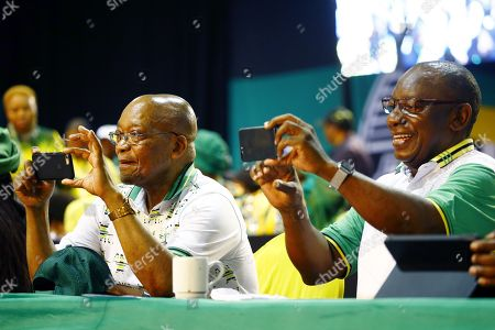 New ANC President Cyril Ramaphosa (R) with outgoing president, Jacob Zuma (L) take pictures of the media while on stage during the 54th ANC National Conference held at the NASREC Convention Centre, Johannesburg , South Africa, 18 December 2017. President Cyril Ramaphosa Nkosazana Dlamini-Zuma succeeds outgoing ANC President, Jacob Zuma and becomes the 4th ANC President since the end of Apartheid. The ruling ANC has been reeling recently under allegations of corruption and and loss of support from its core voters. The ANC (African National Congress) formally led by Nelson Mandela, led the country to freedom from white rule and the Apartheid system during the first free and fair elections in 1994. The convention ends Wednesday.
