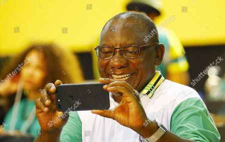 New ANC President Cyril Ramaphosa takes pictures of the media during the 54th ANC National Conference held at the NASREC Convention Centre, Johannesburg , South Africa, 18 December 2017. President Cyril Ramaphosa Nkosazana Dlamini-Zuma succeeds outgoing ANC President, Jacob Zuma and becomes the 4th ANC President since the end of Apartheid. The ruling ANC has been reeling recently under allegations of corruption and and loss of support from its core voters. The ANC (African National Congress) formally led by Nelson Mandela, led the country to freedom from white rule and the Apartheid system during the first free and fair elections in 1994. The convention ends Wednesday.