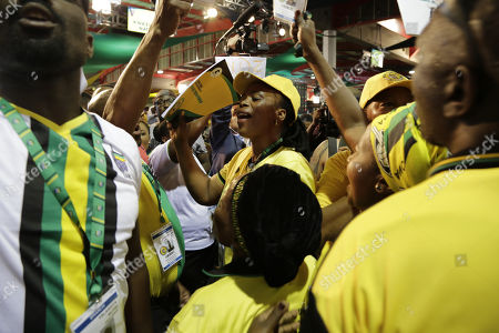 Delegates dance and sing during the 54th ANC National Conference held at the NASREC Convention Centre, Johannesburg , South Africa, 18 December 2017. President Cyril Ramaphosa Nkosazana Dlamini-Zuma succeeds outgoing ANC President, Jacob Zuma and becomes the 4th ANC President since the end of Apartheid. The ruling ANC has been reeling recently under allegations of corruption and and loss of support from its core voters. The ANC (African National Congress) formally led by Nelson Mandela, led the country to freedom from white rule and the Apartheid system during the first free and fair elections in 1994. The convention ends Wednesday.