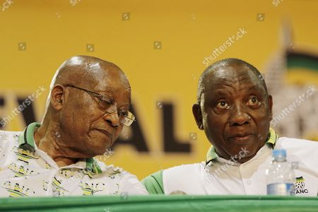 ANC Deputy President Cyril Ramaphosa (R) and outgoing President Jacob Zuma (L) during the 54th ANC National Conference held at the NASREC Convention Centre, Johannesburg , South Africa, 18 December 2017. Ramaphosa and Nkosazana Dlamini-Zuma face off to see who succeeds outgoing ANC President, Jacob Zuma and becomes the 4th ANC President since the end of Apartheid. The ruling ANC has been reeling recently under allegations of corruption and and loss of support from its core voters. The ANC (African National Congress) formally led by Nelson Mandela, led the country to freedom from white rule and the Apartheid system during the first free and fair elections in 1994. The convention ends Wednesday.
