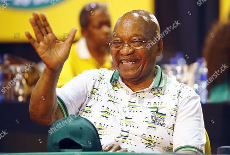 Stock Picture of Outgoing ANC President, Jacob Zuma, waves at fans on stage during the 54th ANC National Conference held at the NASREC Convention Centre, Johannesburg , South Africa, 18 December 2017. President Cyril Ramaphosa Nkosazana Dlamini-Zuma succeeds outgoing ANC President, Jacob Zuma and becomes the 4th ANC President since the end of Apartheid. The ruling ANC has been reeling recently under allegations of corruption and and loss of support from its core voters. The ANC (African National Congress) formally led by Nelson Mandela, led the country to freedom from white rule and the Apartheid system during the first free and fair elections in 1994. The convention ends Wednesday.