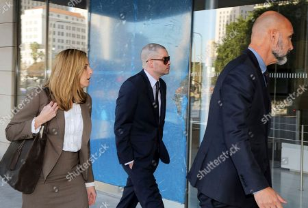"""Former """"Glee"""" actor Mark Salling, center, arrives at federal court in Los Angeles on . Salling has pleaded guilty to possession of child pornography"""