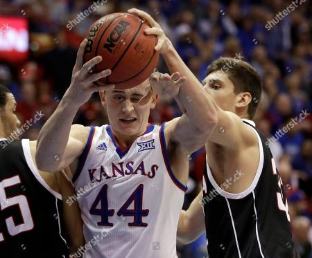 Mitch Lightfoot, Daniel Meyer, Zach Jackson. Kansas forward Mitch Lightfoot (44) rebounds against Omaha forward Daniel Meyer, right, and guard Zach Jackson (25) during the second half of an NCAA college basketball game in Lawrence, Kan