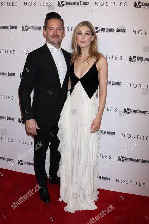 Scott Cooper and Rosamund Pike