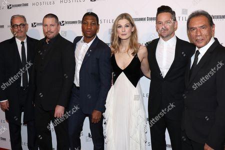 John Lesher, Christian Bale, Jonathan Majors, Rosamund Pike, Scott Cooper and Wes Studi