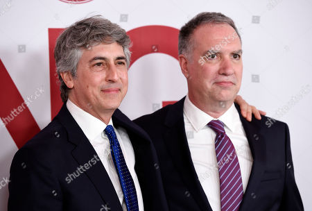 "Alexander Payne, Jim Taylor. Alexander Payne, left, director/co-writer/producer of ""Downsizing,"" poses with the film's co-writer/producer Jim Taylor at a special screening of the film at the Regency Village Theatre, in Los Angeles"