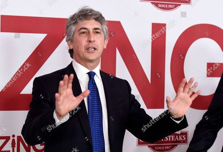 "Alexander Payne, director/co-writer of ""Downsizing,"" banters with photographers at a special screening of the film at the Regency Village Theatre, in Los Angeles"