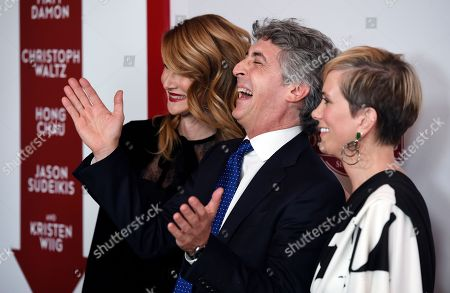 "Laura Dern, Alexander Payne, Kristen Wiig. Alexander Payne, center, the director and co-writer of ""Downsizing,"" shares a laugh with cast members Laura Dern, left, and Kristen Wiig at a special screening of the film at the Regency Village Theatre, in Los Angeles"